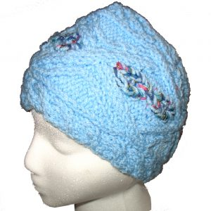 Child's blue hand knit hat with multi-color cable